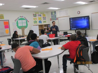 Student listening to Mr. Banaag, Algebra I Teacher