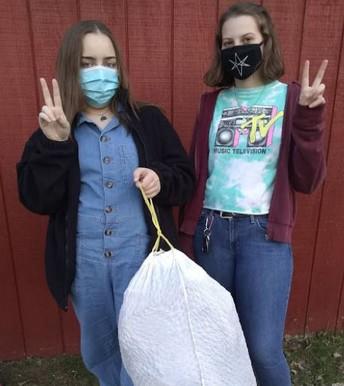 Hannah Richards and Kristen Crump work on environmental clean up.