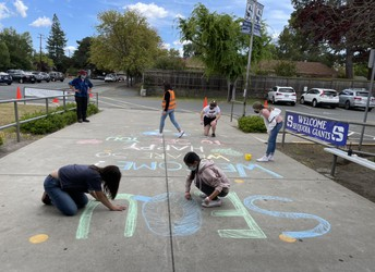 Sprucing up the chalk art welcoming message