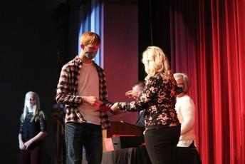 Joshua Meservey receives his academic letter from Mrs. Tipton.