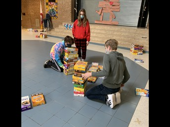 Intermediates gathering and counting our cereal boxes