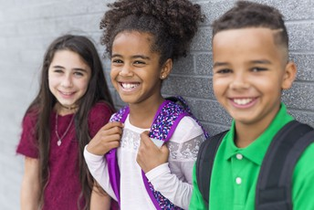 Three children smiling.