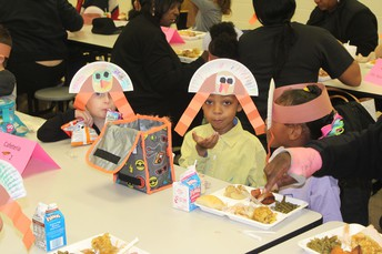 Our cute PreK students enjoying Thanksgiving lunch!