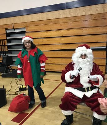Santa and his elf.