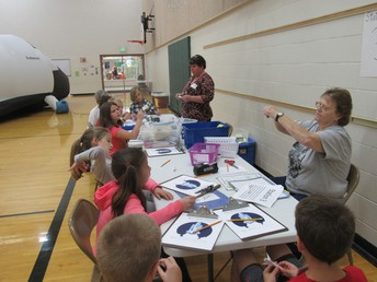 Third grade students had a great time learning about the space shuttle and rockets.