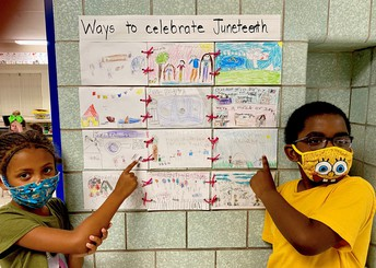 Students displaying quilt