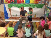 Mr. Eaton and Asher reading to the class.