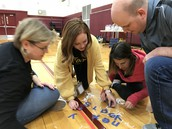 Working together under pressure of 450 kids cheering!