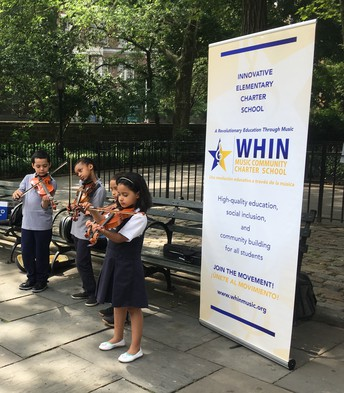 Students performing at J. Hood Park last summer.