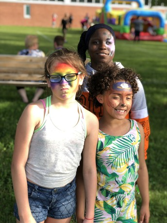 Three young ladies at the OSSB End of the Year Bash held in collaboration with the 21st Century Community Learning Centers grant, and OSSB Residential Department. Shown with their faces painted are left to right, Bryanna, Qua and Lyric.