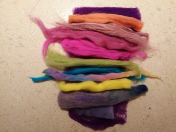 A selection of different colour merino tops for the design layers.