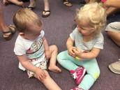 Josie & Clara making friends at Playgroup.