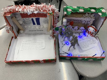 Ms. Void's class made Dioramas using lyrics of Holiday Jingles to study rhyme patterns, meters, and stanzas.