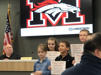 Recognizing our school-wide winner @ MPS School Board Meeting!