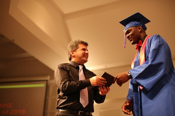Mr. Dibi receiving an award from the senior class