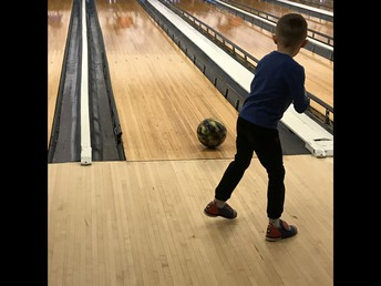 Grayson fires the ball down the lane!