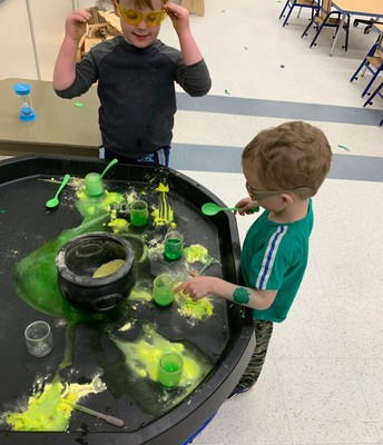 Pathways students celebrating St. Patrick's Day with potions, Mat Leprechaun and a dance party!