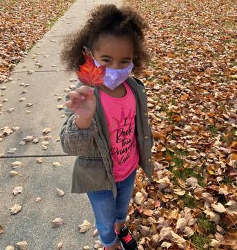 Student holding leaf.