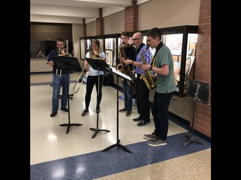 Members from the UHS Bands (teachers and students) play for students at lunch