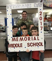Veteran and former RSD 13 student, Ryan Parmelee and students at Memorial's Veterans Day Luncheon