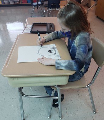 Student drawing self portrait