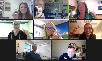 staff members on zoom call with goat trophies