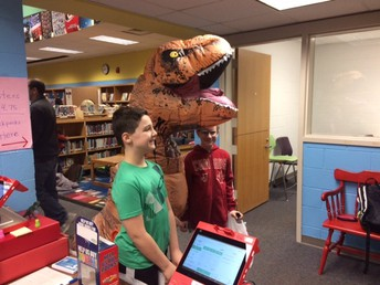 Scholastic Dino-Mite: Stomp, Chomp & Read Book Fair Open Until Wednesday, March 13