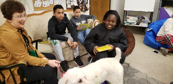 Reading to our visiting Therapy Dogs