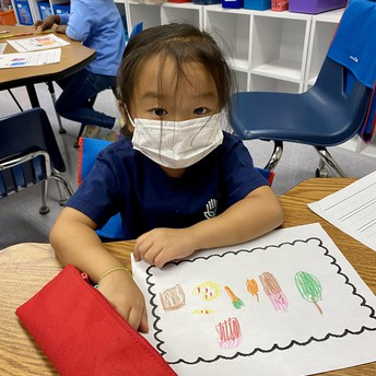 A student draws a picture of food.