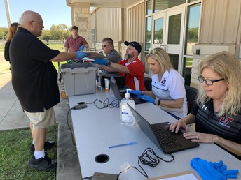 Technology staff providing devices to support online learning