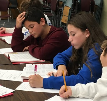 8th Grade Embraces Science & History To Develop Info Text Skills