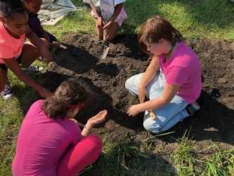Maize students get ready for the new soil.