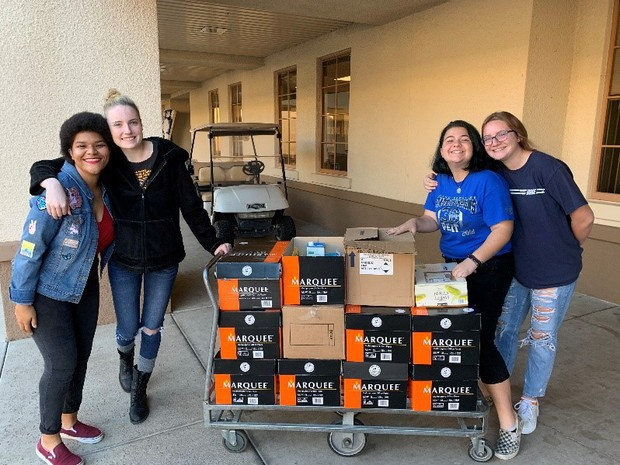 Chandler High students help distribute food