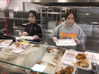Belinda Alonzo & Nayali Serving Students Lunch