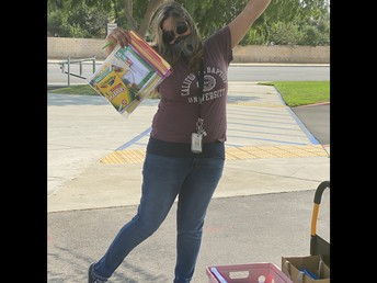 Mrs. Garcia passing out student care packages.
