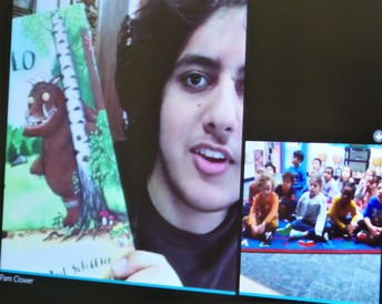 First graders being read to via Skype by students from an International School in London.