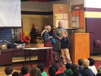 Yakub Halilovic receiving his bucket from Ms. Lateef