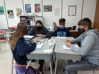 8th grade plays an equivalent fraction board game