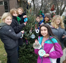Interact Club Decorates Tree at BPL Snowman Crossing