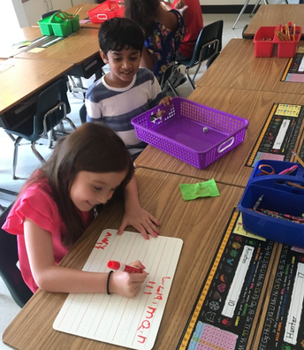 First graders practicing their math skills and 5Cs!