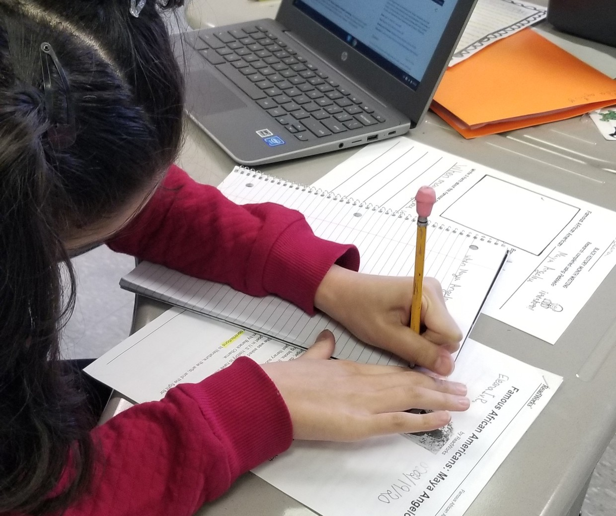 Student working at a desk.