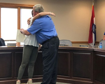 Director Stiers gives his daughter Allison a congratulatory hug