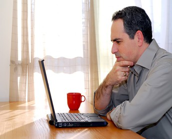 Man viewing items on laptop