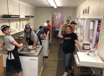 Students in band volunteerng at the Dairy Barn extension in the Ag Building
