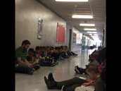 Hallway Huddle- Everyone at Elmdale in the hallways reading
