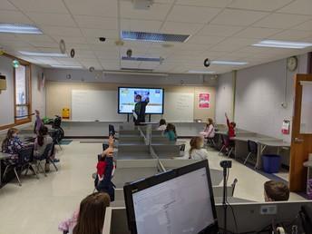 Mr. Hellerman teaching 3rd graders.