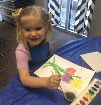 Creating in the style of Picasso, children paint flowers and stems...