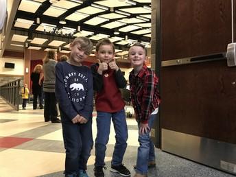 Kindergarteners Beckham Hall, Joel Johnson and Brady Dewald