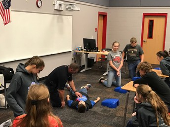 9th & 10th graders are instructed in CPR.