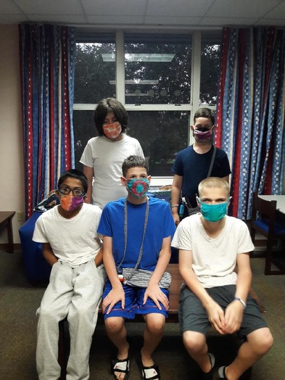 Group of boys wearing their tie-dyed masks